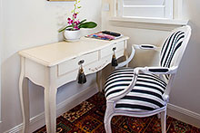 Striped chair at desk